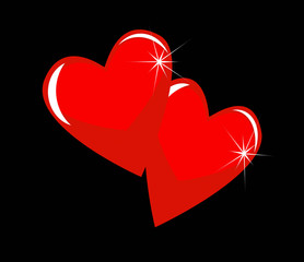 two bright red hearts on a black background