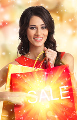 A beautiful woman with shopping bags on a bright background