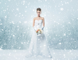 A sexy bride in erotic lingerie on a snowy background