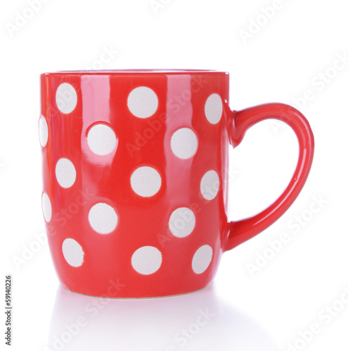 Red polka dot mug isolated on white