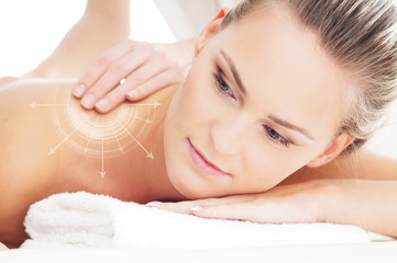 A young and beautiful woman on a back massage procedure
