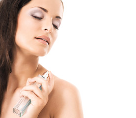 Beauty portrait of a young woman holding a body spray