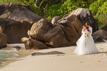 newlyweds with wedding bouquet