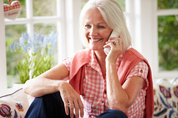 Middle Aged Woman At Home Talking On Phone