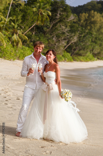 newlyweds with wedding bouquet