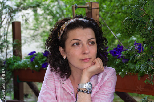 Woman sitting at a table watching