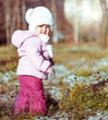 little girl enjoys the arrival of winter