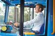 Portrait Of Bus Driver Behind Wheel - 59144665
