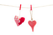 two hanging red  hearts on white