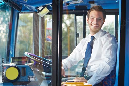 Leinwanddruck Bild Portrait Of Bus Driver Behind Wheel