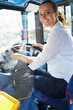 Portrait Of Female Bus Driver Behind Wheel - 59145040