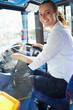 Leinwanddruck Bild - Portrait Of Female Bus Driver Behind Wheel