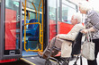Leinwandbild Motiv Senior Couple Boarding Bus Using Wheelchair Access Ramp