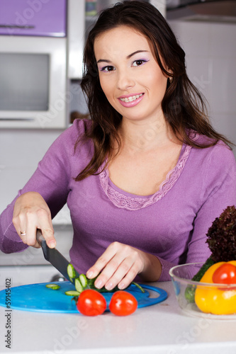 Pretty  woman cooking food in the kitchen