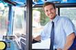 Leinwanddruck Bild - Portrait Of Bus Driver Behind Wheel
