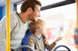 Father And Son Enjoying Bus Journey Together - 59146077