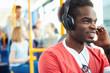 Man Wearing Headphones Listening To Music On Bus Journey - 59146484