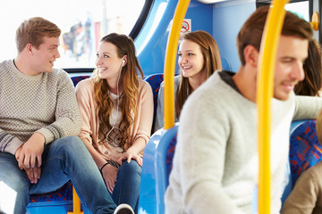 Group Of Young People On Bus Journey Together