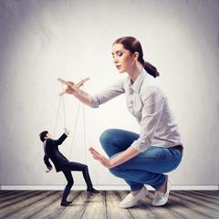 Businesswoman puppeteer