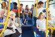 Leinwandbild Motiv Interior Of Bus With Passengers