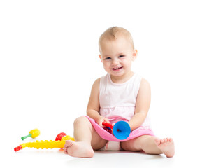 baby playing with musical toys isolated on white background