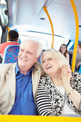 Senior Couple Enjoying Journey On Bus