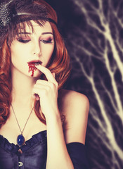 Redhead vampire woman in mask