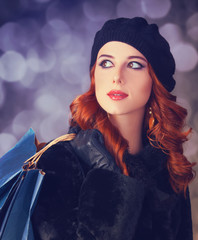Redhead with with bag.