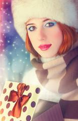 Beautiful redhead women with gift.