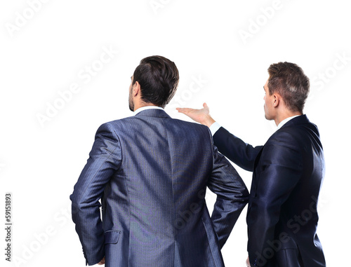 Two business mans from the back - looking at something