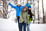 Active family - mother and kids running in winter park