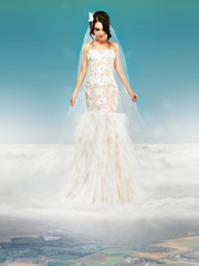 Bride in Wedding Dress on Cloud and Looking to the Ground