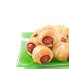Sausages in dough isolated on white background