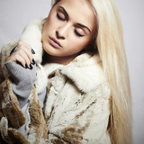 Beautiful blond woman in dress.accessories.winter fashion