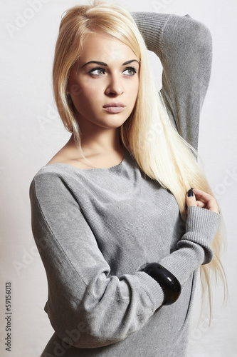 Beautiful blond woman in dress.accessories.flirt.fashion.