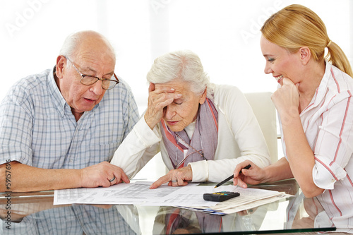 Senior couple with financial advisor