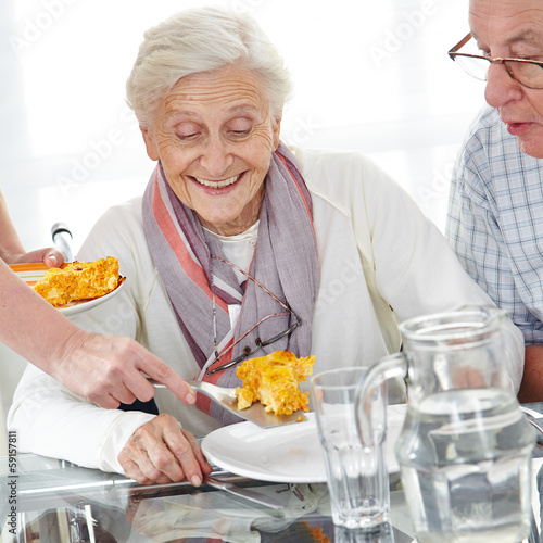 Senior citizen couple eating lunch
