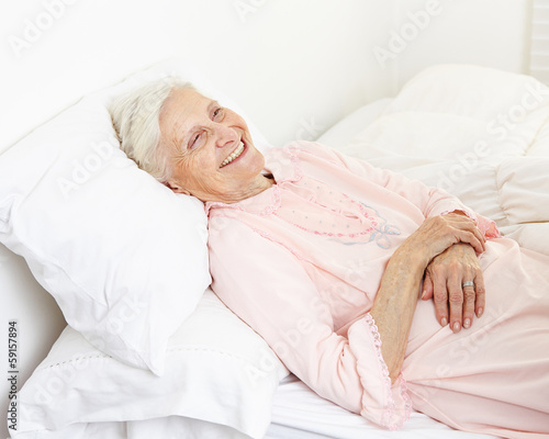 Beddridden senior citizen woman smiling