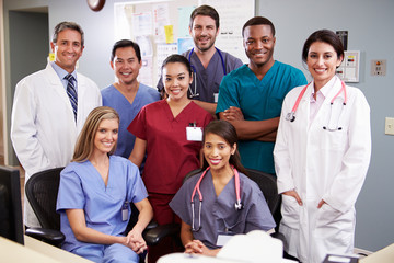 Portrait Of Medical Team At Nurses Station