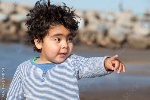 surprised little boy pointing with his finger