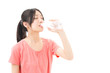 young sporty asian woman drinking water