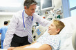 Boy Talking To Male Consultant In Emergency Room