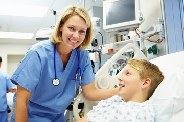 Boy Talking To Female Nurse In Emergency Room