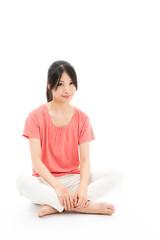 young asian sporty woman relaxing on white background
