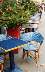 Parisian outdoor cafe decorated for Christmas