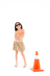 Little girl with construction cone