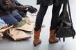 Beggar on a crowded street