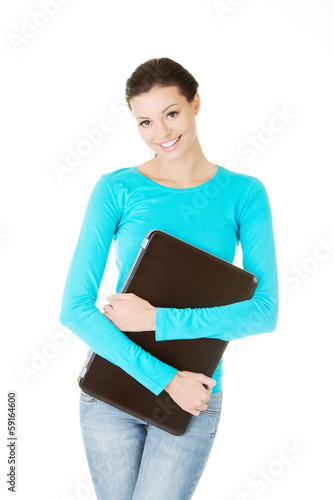 beautiful casual woman holding a laptop.