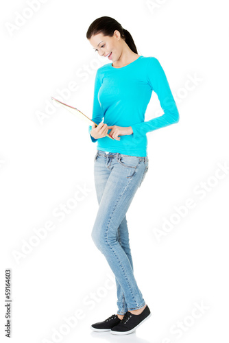beautiful casual woman holding  files.