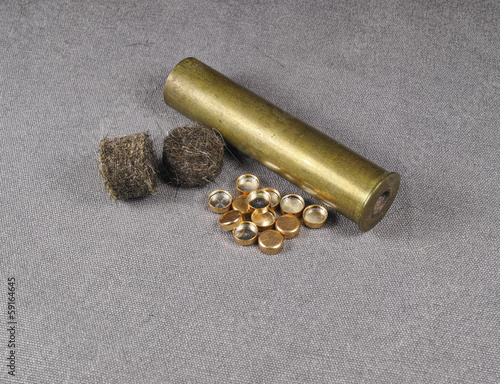 percussion caps and felt wad and brass shell